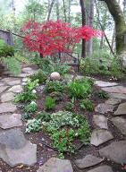 flowers and plants in circle created by flagstone walkway